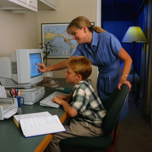 Mother Helping Son at Computer
